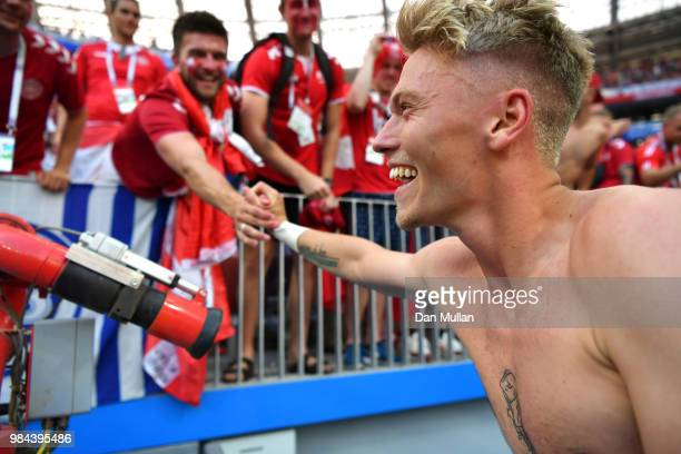 Viktor Fischer of Denmark gives his shirt to the fans following the 2018 FIFA World Cup Russia group C match between Denmark and France at Luzhniki...