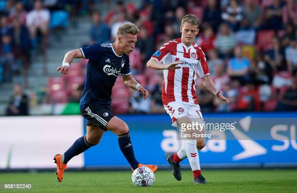 Viktor Fischer of FC Copenhagen and Kasper Kusk of AaB Aalborg compete for the ball during the Danish Alka Superliga match between AaB Aalborg and FC...