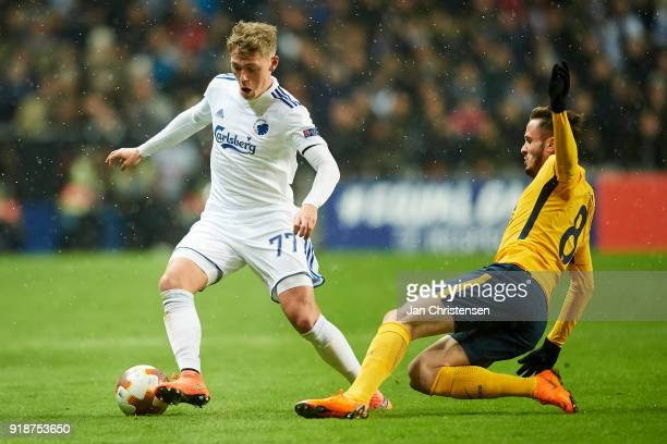 Viktor Fischer of FC Copenhagen and Saúl Niguez of Atlético Madrid compete for the ball during the UEFA Europa League match between FC Copenhagen and...