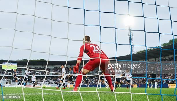 Viktor Fischer of FC Copenhagen scores the 11 goal against Goalkeeper Aleksandar Jovanovic of AGF Aarhus during the Danish Superliga match between...