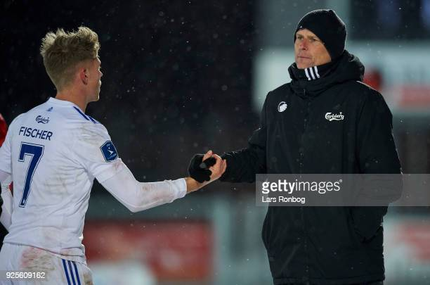 Viktor Fischer of FC Copenhagen shake hands with Stale Solbakken head coach of FC Copenhagen during the Danish Alka Superliga match between Hobro IK...