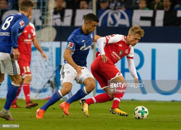 Viktor Fischer of Mainz and Franco Matias Di Santo of Schalke battle for the ball during the Bundesliga match between FC Schalke 04 and 1 FSV Mainz...