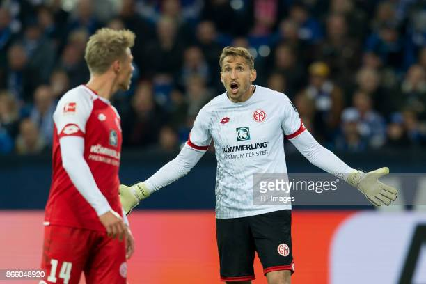 Viktor Fischer of Mainz and goalkeeper Rene Adler of Mainz gestures during the Bundesliga match between FC Schalke 04 and 1 FSV Mainz 05 at...