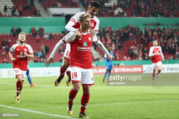 Viktor Fischer of Mainz celebrates his team's first goal with team mate Kenan Kodro during the DFB Cup match between 1 FSV Mainz 05 and Holstein Kiel...