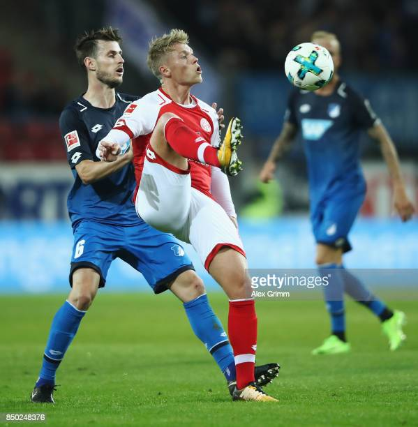 Viktor Fischer of Mainz is challenged by Havard Nordtveit of Hoffenheim during the Bundesliga match between 1 FSV Mainz 05 and TSG 1899 Hoffenheim at...
