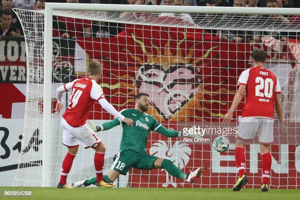 Viktor Fischer of Mainz scores his team's second goal past goalkeeper Kenneth Kronholm of Kiel during the DFB Cup match between 1 FSV Mainz 05 and...