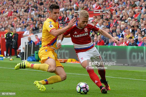 Viktor Fischer of Middlesbrough and Scott Dann of Crystal Palace battle for possession during the Premier League match between Middlesbrough and...