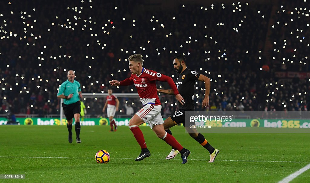 Viktor Fischer of Middlesbrough is chased by Ahmed Elmohamady of Hull City as fans light up the stadium during the Premier League match between Middlesbrough and Hull City at Riverside Stadium on December 5, 2016 in Middlesbrough, England.