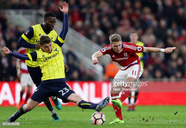 Viktor Fischer of Middlesbrough shoots while Ryan Ledson of Oxford United attempts to block during The Emirates FA Cup Fifth Round match between...