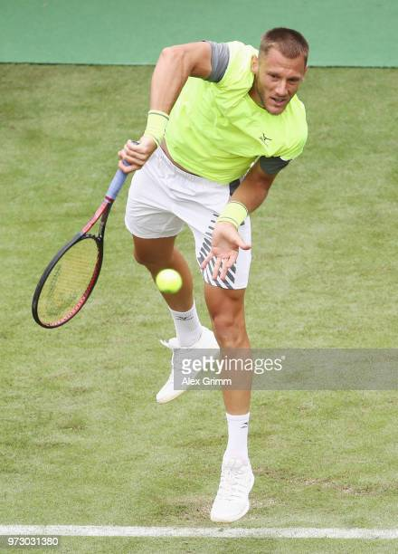 Viktor Galovic of Croatia serves the ball to Maximilian Marterer of Germany during day 3 of the Mercedes Cup at Tennisclub Weissenhof on June 13,...