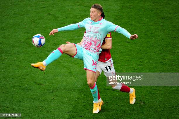 Viktor Gyökeres of Swansea City battles with Callum O'Dowda of Bristol City during the Sky Bet Championship match between Bristol City and Swansea...