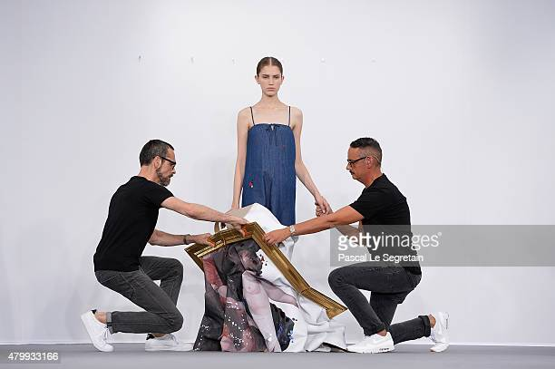 Viktor Horsting a model and Rolf Snoeren pose on the runway during the Viktor Rolf show as part of Paris Fashion Week Haute Couture Fall/Winter...