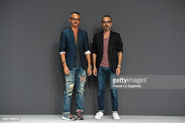 Viktor Horsting and Rolf Snoeren pose on the runway during the Viktor Rolf Haute Couture Fall/Winter 20162017 show as part of Paris Fashion Week on...