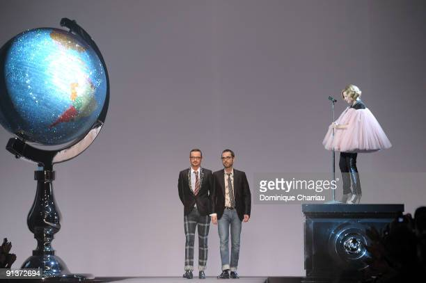 Viktor Horsting and Rolf Snoeren walk the runway while Roisin Murphy performs during the Viktor Rolf Spring / Summer 2010 Pret a Porter show as part...