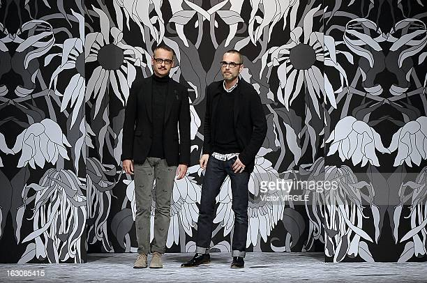 Viktor Horsting and Rolf Snoeren walks the runway during the ViktorRolf Fall/Winter 2013 ReadytoWear show as part of Paris Fashion Week on March 2...