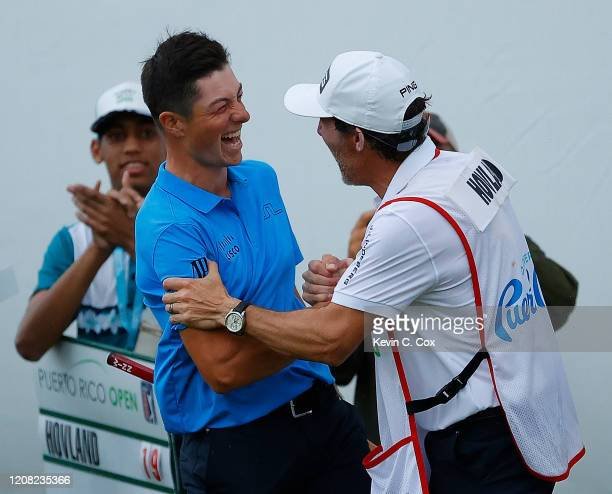 Viktor Hovland of Norway celebrates with his caddie Shay Knight on the 18th green after making his birdie putt to win the Puerto Rico Open at Grand...