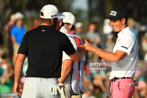 Viktor Hovland of Norway celebrates with Matthew Wolff of the United States after they both birdied the 17th hole during the first round of The...