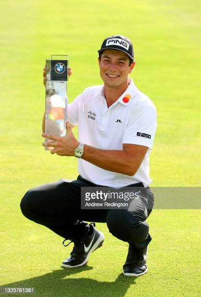 Viktor Hovland of Norway celebrates with the winners trophy after the final round of The BMW International Open at Golfclub Munchen Eichenried on...