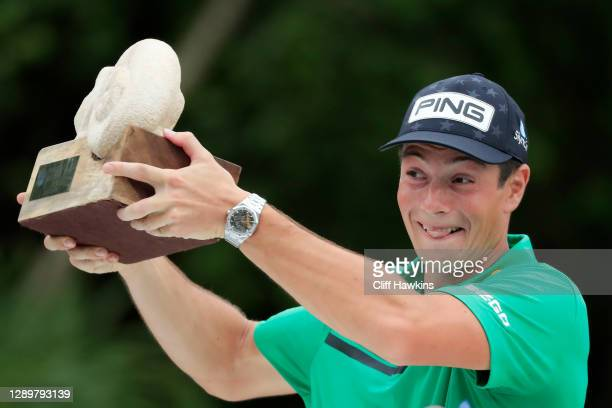 Viktor Hovland of Norway celebrates with the winner's trophy on the 18th green after the final round of the Mayakoba Golf Classic at El Camaleón Golf...