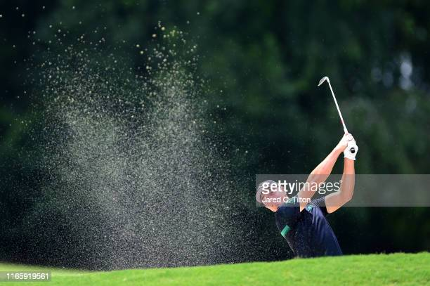 Viktor Hovland of Norway plays a shot from a bunker on the tenth hole during the third round of the Wyndham Championship at Sedgefield Country Club...