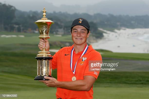 Viktor Hovland of Norway poses with the Havemeyer Trophy after winning the championship match for the US Amateur Championship at Pebble Beach Golf...