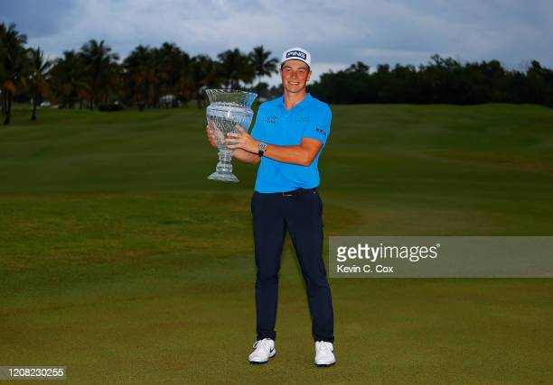 Viktor Hovland of Norway poses with the trophy on the 18th green after winning the Puerto Rico Open at Grand Reserve Country Club on February 23 2020...