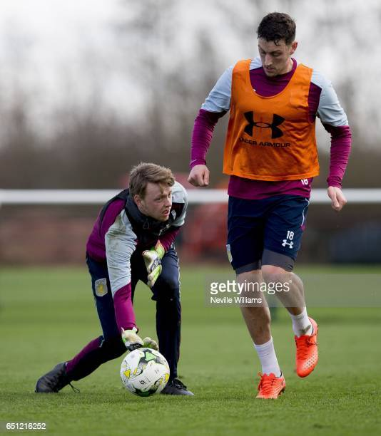 Viktor Johansson of Aston Villa in action with team mate Tommy Elphick during a Aston Villa training session at the club's training ground at...