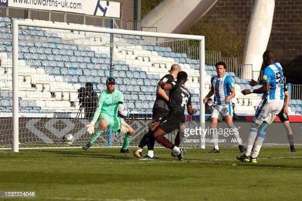Viktor Johansson of Rotherham United saves the effort of Yaya Sanogo of Huddersfield Town during the Sky Bet Championship match between Huddersfield...