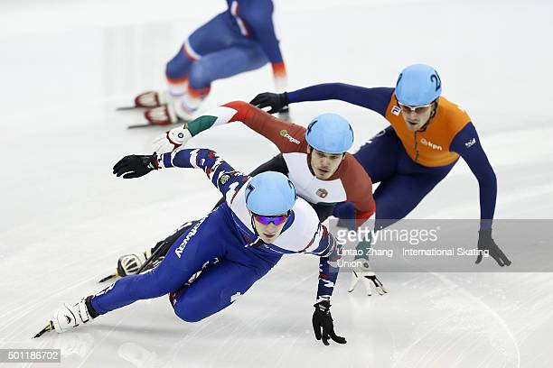 Viktor Knoch of Hungary and Dmitry Migunov of Russia competes in the men's 500m final on day two of the ISU World Cup Short Track speed skating event...