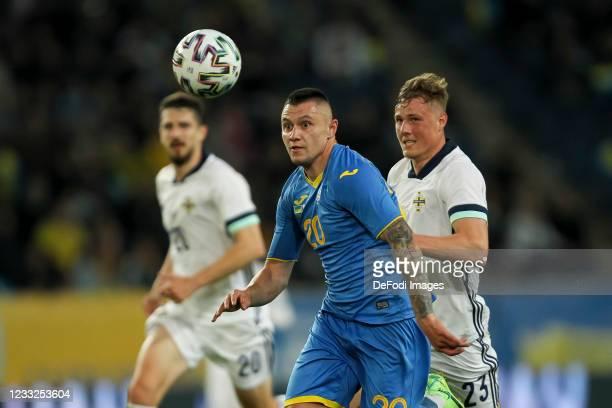 Viktor Kovalenko of Ukraine and Daniel Ballard of Northern Ireland battle for the ball during the international friendly match between Ukraine and...