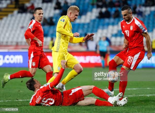 Viktor Kovalenko of Ukraine in action against Nemanja Maksimovic Milan Rodic and Nikola Maksimovic of Serbia during the UEFA Euro 2020 Qualifier...