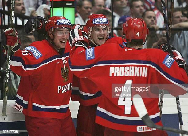 Viktor Kozlov, Alexei Yashin and Vitali Proshkin of Russia celebrate the game tying goal against Slovakia in the IIHF World Men's Championships...
