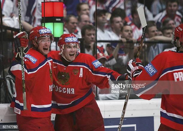 Viktor Kozlov, Alexei Yashin and Vitali Proshkin of Russia celebrate the game tying goal by Kozlov against Slovakia in the IIHF World Men's...