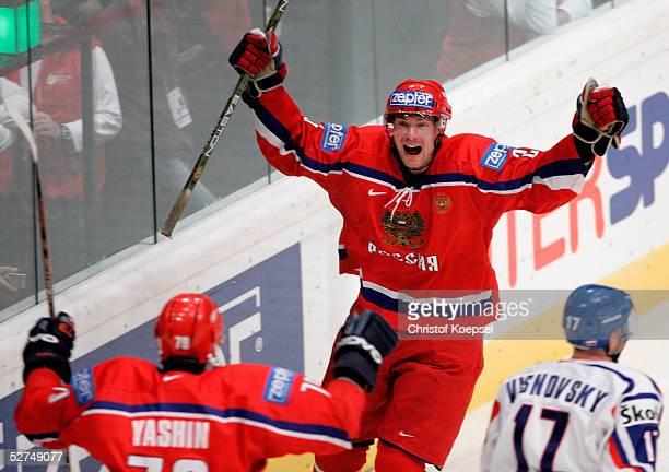 Viktor Kozlov of Russia celebrates his third goal with Alexei Yashin in the IIHF World Men's Championships Preliminary Round match between Slovakia...