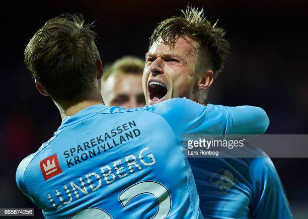 Viktor Lundberg and Marvin Pourie of Randers FC celebrate after scoring their first goal during the Danish Alka Superliga match between Randers FC...
