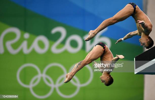 Viktor Minibaev and Nikita Shleikher of Russia in action during the Men's Synchronised 10m Platform Final Swimming event of the Rio 2016 Olympic...