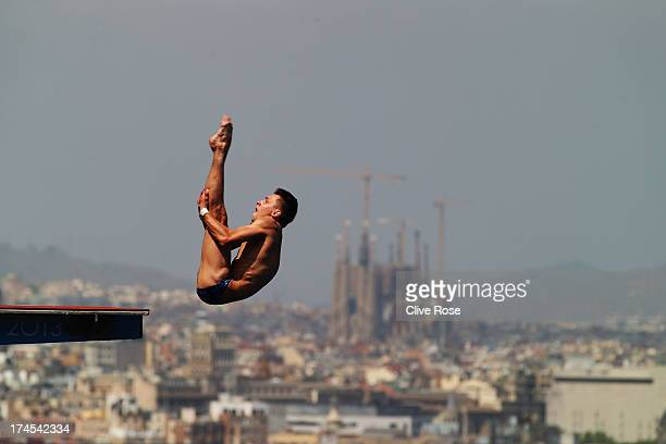 Viktor Minibaev of Russia competes in the Men's 10m Platform Diving Semifinal round on day eight of the 15th FINA World Championships at Piscina...