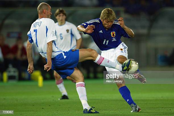 Viktor Onopko of Russia blocks the shot from Takayuki Suzuki of Japan during the FIFA World Cup Finals 2002 Group H match played at the International...