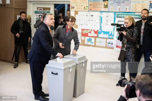 Viktor Orban Hungary's prime minister casts his vote with his wife Aniko Levai at a polling station during parliamentary elections in Budapest...