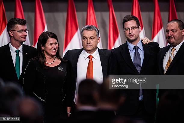 Viktor Orban Hungary's prime minister center stands with politicians from the Fidesz party Gabor Kubatov left Ildiko Pelczne Gal second left Gergely...