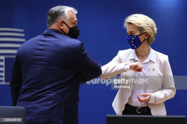 Viktor Orban, Hungary's prime minister, left, greets Ursula von der Leyen, president of the European Commission, with an 'elbow bump' during a...