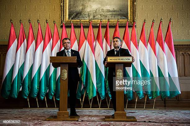Viktor Orban Hungary's prime minister right and Gyorgy Matolcsy governor of Hungary's central bank hold a joint news conference at the national...