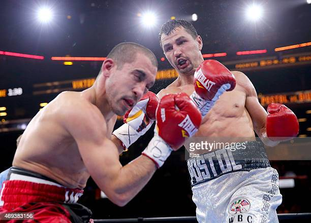 Viktor Postol of Ukraine and Jake Giuriceo exchange punches during the Premier Boxing Champions Welterweight bout at Barclays Center on April 11,...