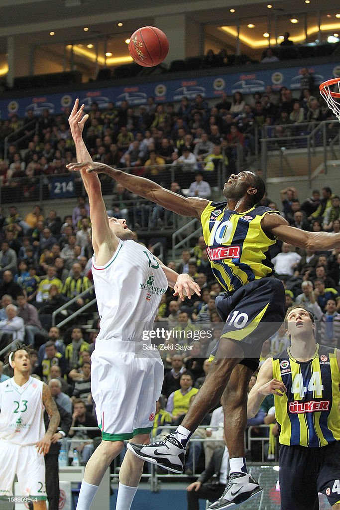 Viktor Sanikidze #13 of Montepaschi Siena competes with Romain Sato #10 of Fenerbahce Ulker during the 2012-2013 Turkish Airlines Euroleague Top 16 Date 2 between Fenerbahce Ulker Istanbul v Montepaschi Siena at Fenerbahce Ulker Sports Arena on January 4, 2013 in Istanbul, Turkey.