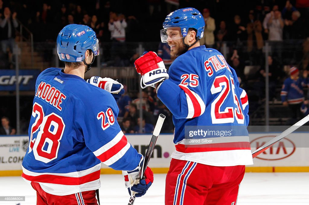 Viktor Stalberg #25 and Dominic Moore #28 of the New York Rangers celebrate after a goal in the third period against the San Jose Sharks at Madison Square Garden on October 19, 2015 in New York City.
