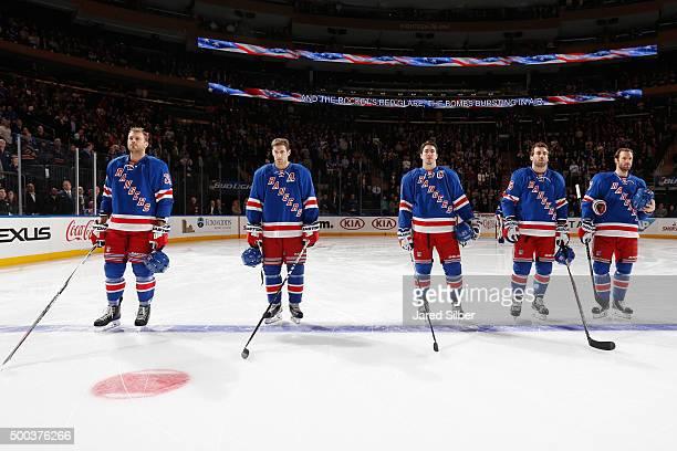 Viktor Stalberg Dan Girardi Ryan McDonagh Jarret Stoll and Dominic Moore of the New York Rangers line up during the singing of the national anthem...