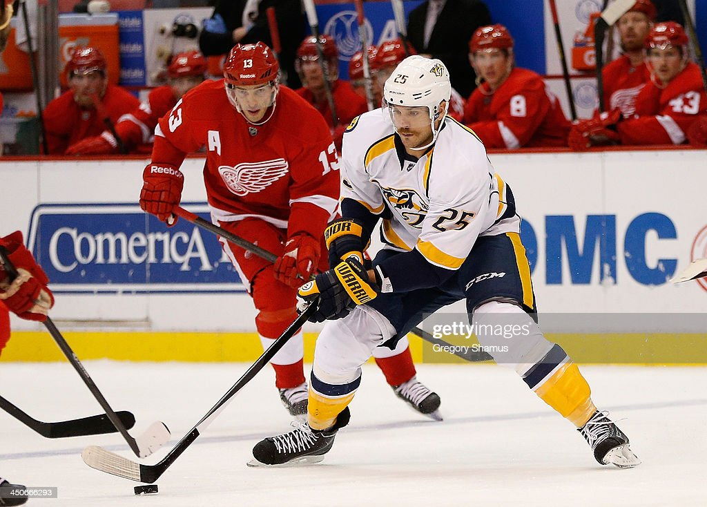 Viktor Stalberg #25 of the Nashville Predators controls the puck in front of Pavel Datsyuk #13 of the Detroit Red Wings during the third period at Joe Louis Arena on November 19, 2013 in Detroit, Michigan. Nashville won the game 2-0.