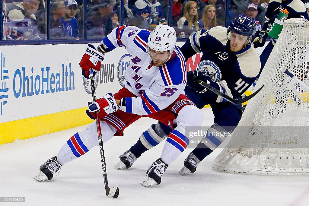 Viktor Stalberg #25 of the New York Rangers attempts to skate the puck past Alexander Wennberg #41 of the Columbus Blue Jackets during the third period on April 4, 2016 at Nationwide Arena in Columbus, Ohio. New York defeated Columbus 4-2.