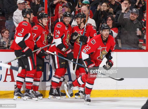 Viktor Stalberg of the Ottawa Senators celebrates his first period goal against the Columbus Blue Jackets with teammates Marc Methot Tommy Wingels...