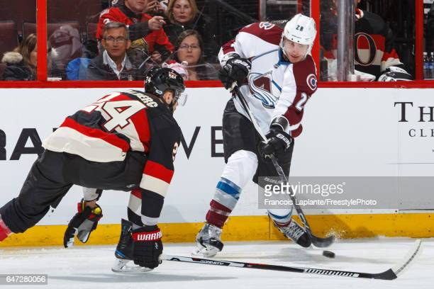 Viktor Stalberg of the Ottawa Senators defends as Patrick Wiercioch of the Colorado Avalanche fires a shot during an NHL game at Canadian Tire Centre...